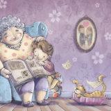 おばあちゃんが孫に絵本の読み聞かせ